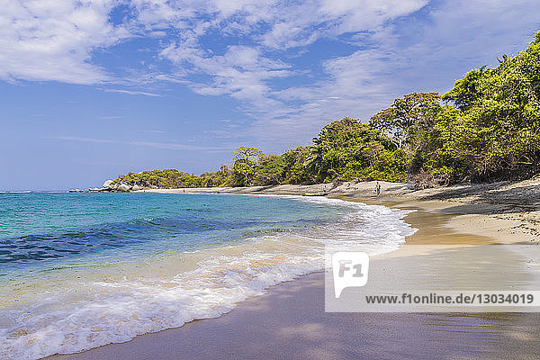 A view of a beach and the Caribbean sea in Tayrona National Park in Colombia