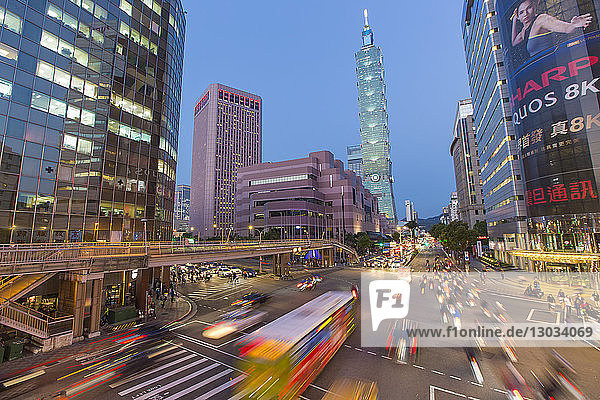 Traffic in front of Taipei 101 at a busy downtown intersection in the Xinyi district  Taipei  Taiwan