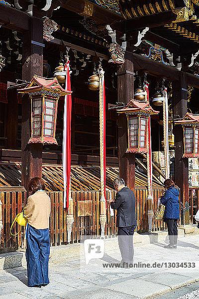People praying at Kitano Tenmangu Shrine  Kyoto  Japan