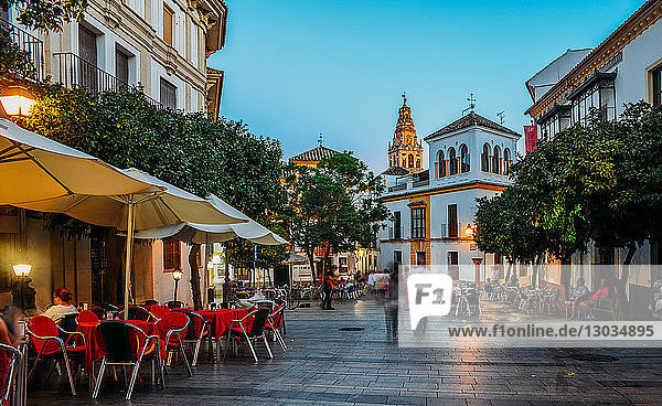 Pedestrian street in the historic centre with the Bell Tower of La Mezquita (Great Mosque) in background  Cordoba  Andalucia  Spain
