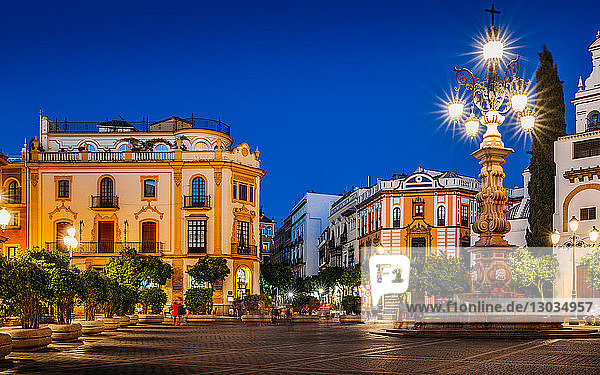Plaza Virgen de los Reyes leading to Calle Mateos Gago at night  Seville  Andalusia  Spain