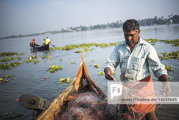 Fisherman on Mahatma Gandhi Beach  Fort Kochi (Cochin)  Kerala  India