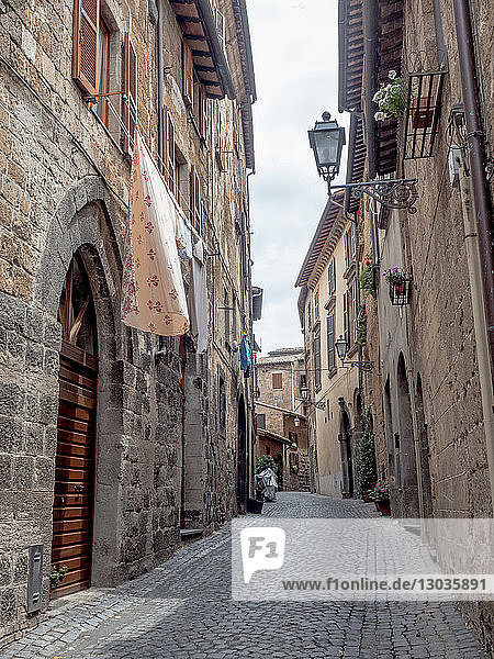 Cobbled medieval street and stone houses  Orvieto  Tuscany  Italy