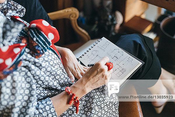 Woman working on designs in her studio