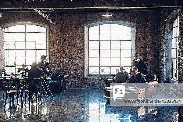 Designers brainstorming in communal space in studio