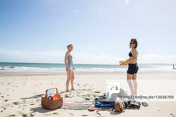 Sisters enjoying themselves on beach