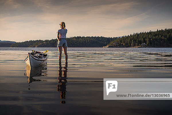 Young female kayaker standing looking out over lake  Quadra Island  Campbell River  Canada