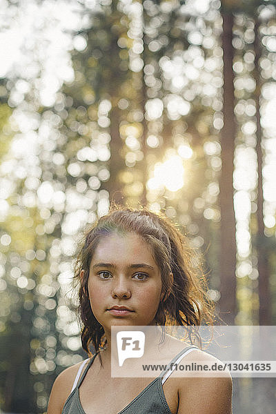 Portrait of confident girl in forest