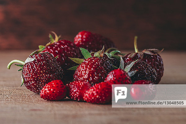Close-up of strawberries on wooden table