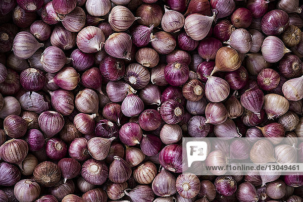 Overhead view of onions for sale at market