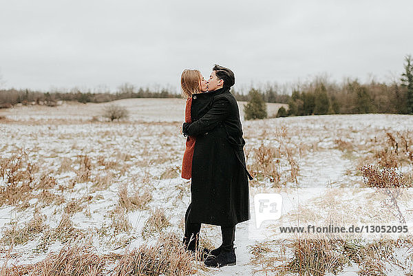 Couple kissing in snow  Georgetown  Canada