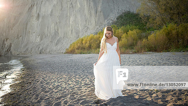 Bride in wedding dress on beach at sunset  Scarborough Bluffs  Toronto  Canada