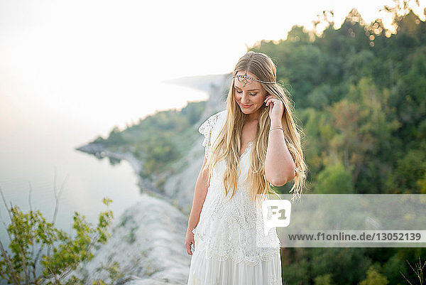 Bride on clifftop by coast  Scarborough Bluffs  Toronto  Canada