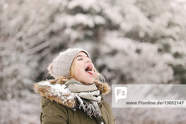 Girl with mouth open waiting for snow