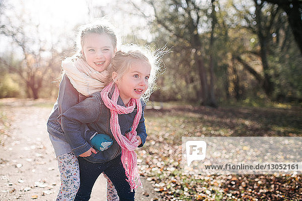 Sisters playing in forest