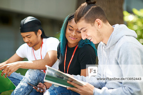 College students reading and talking in campus