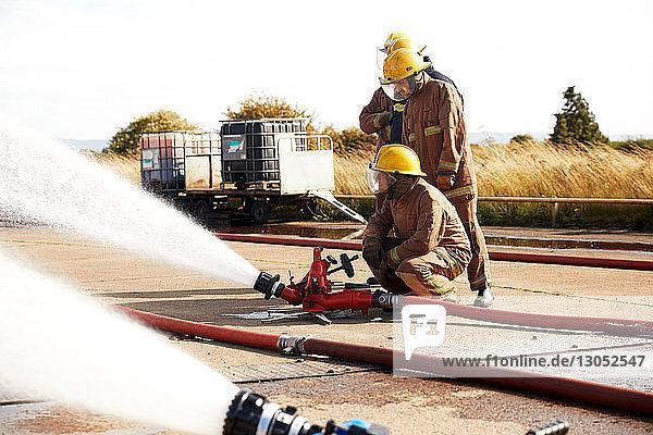 Firemen training to use fire hose  Darlington  UK