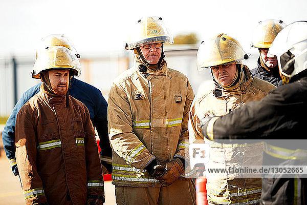 Firemen training  firemen listening to supervisor at training facility