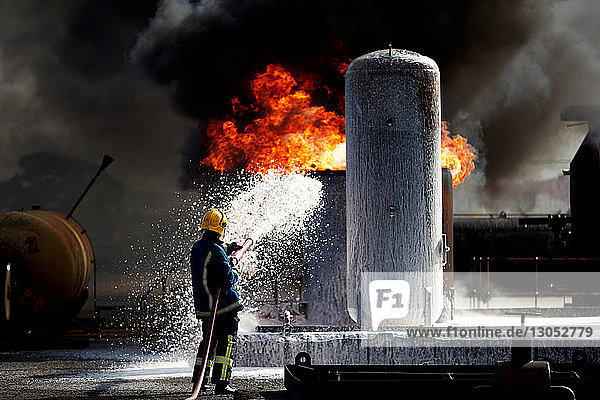 Fireman training to put out fire on burning tanks  Darlington  UK