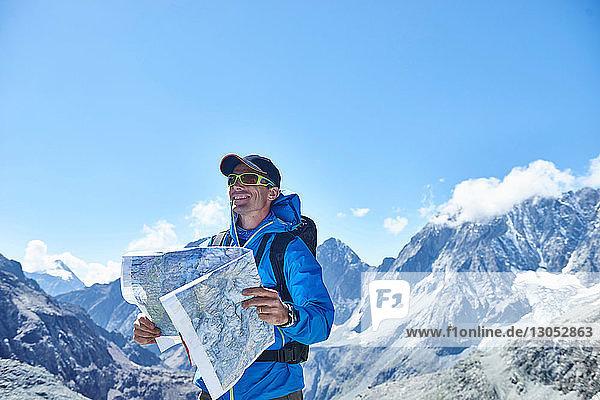 Man reading map  Mont Cervin  Matterhorn  Valais  Switzerland