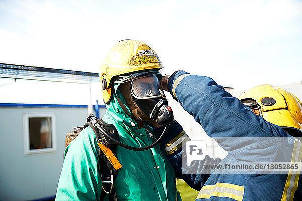 Firemen training to put on fire helmet  Darlington  UK