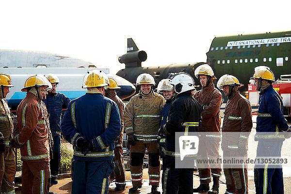Firemen training  large group of firemen listening to supervisor