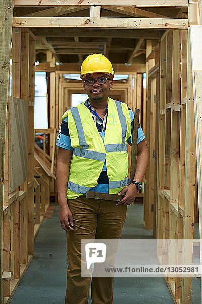 Male higher education carpentry student in college workshop  portrait