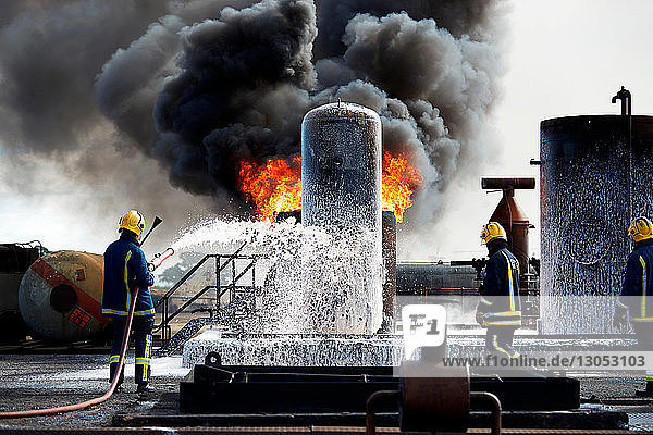 Firemen training to put out fire on burning tanks  Darlington  UK