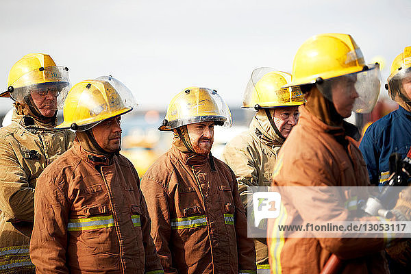 Firemen training  group of firemen listening to instructions