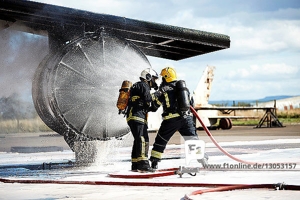 Firemen putting out fire on old training aeroplane  Darlington  UK