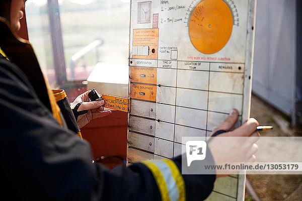 Fireman looking at chart at training centre