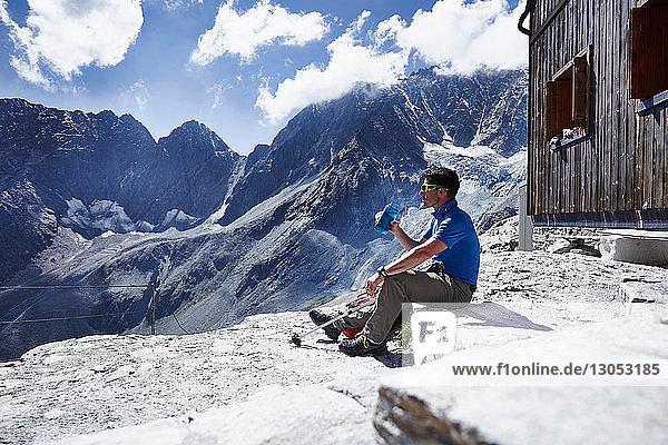 Hiker drinking from water bottle  Mont Cervin  Matterhorn  Valais  Switzerland