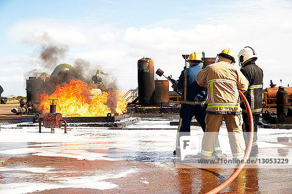 Firemen training,  firemen preparing to put out oil storage tank fire at training facility