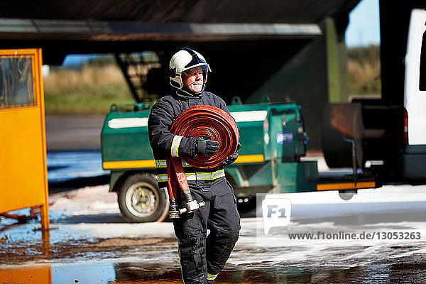 Fireman carrying fire hose reel  Darlington  UK