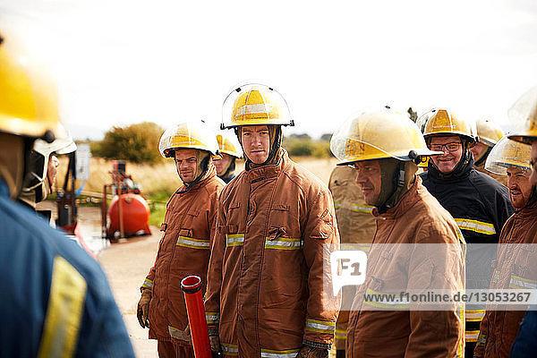 Firemen training  team of firemen listening at meeting at training facility