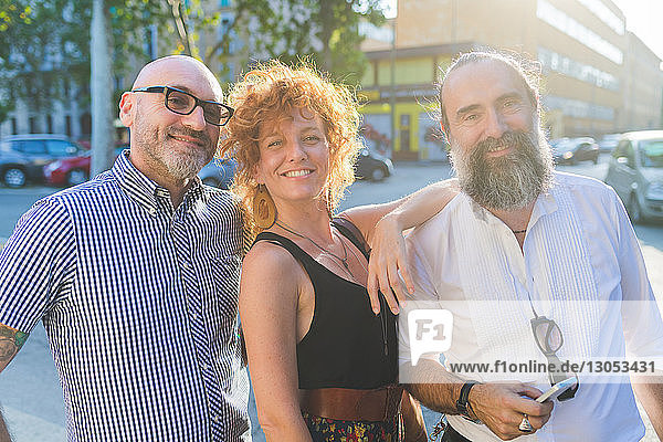 Mid adult woman and male friends on city street  portrait