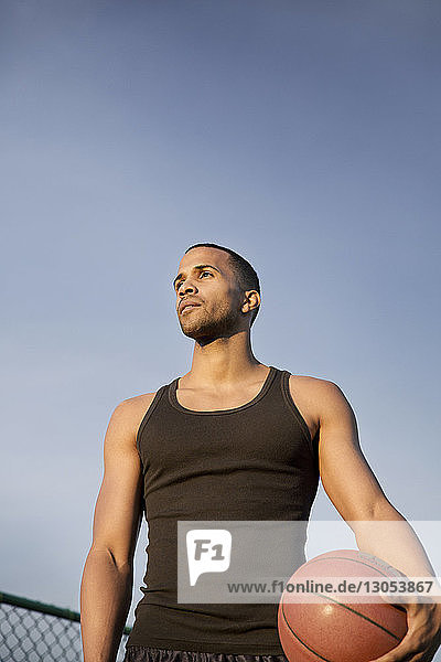 Low angle view of basketball player against sky