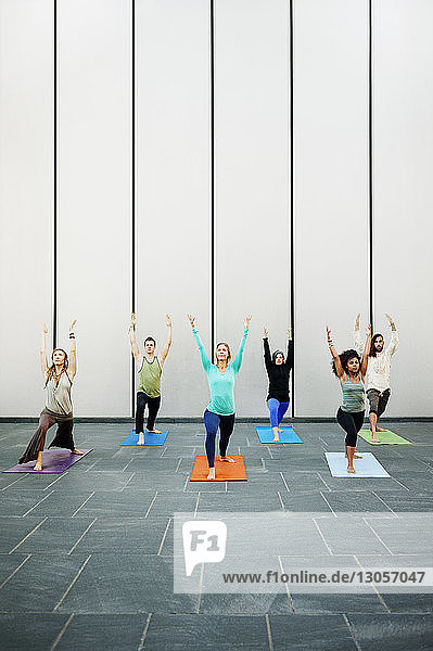 People exercising in yoga class