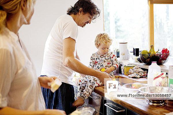 Family preparing meal in kitchen