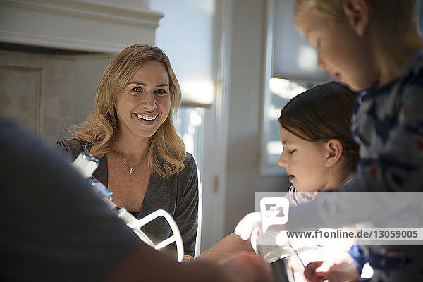 Low angle view of happy family in kitchen