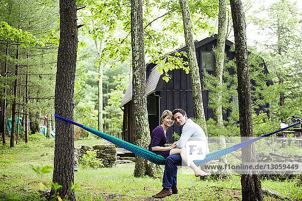 Portrait of couple sitting on hammock