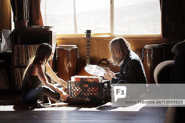 Side view of couple looking at records while sitting at home