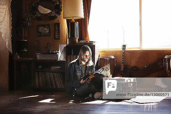 Man looking at records while sitting at home