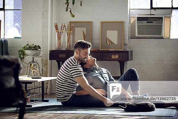 Gay couple relaxing at home