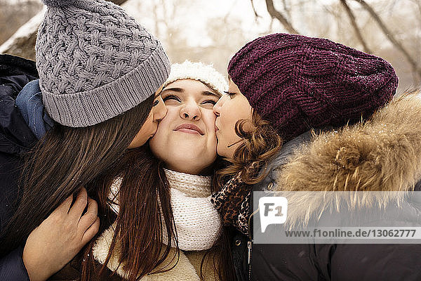 Close-up of women kissing friend