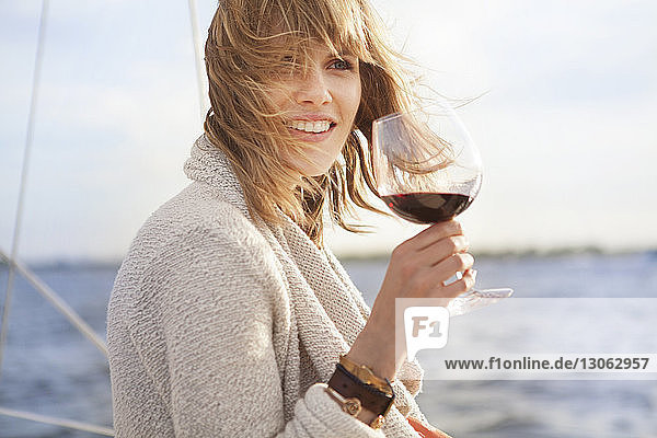 Woman looking away while holding wine glass