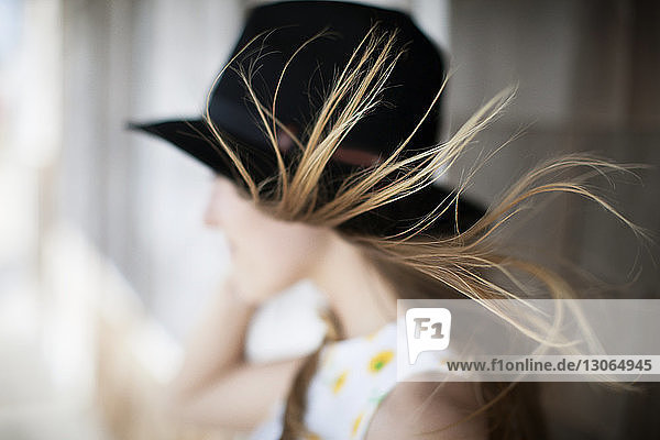 Side view of woman with tousled hair