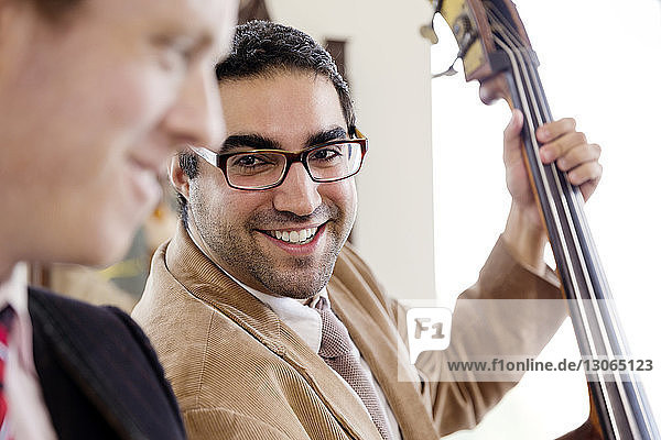 Man looking at friend while practicing in studio