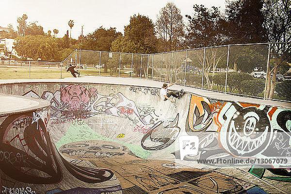 Man skateboarding on sports ramp in park