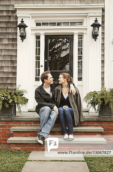 Couple sitting on front stoop